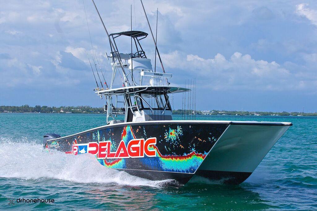 All Lit Up Fishing Charter Boat in Islamorada, Florida Keys - angle view under power