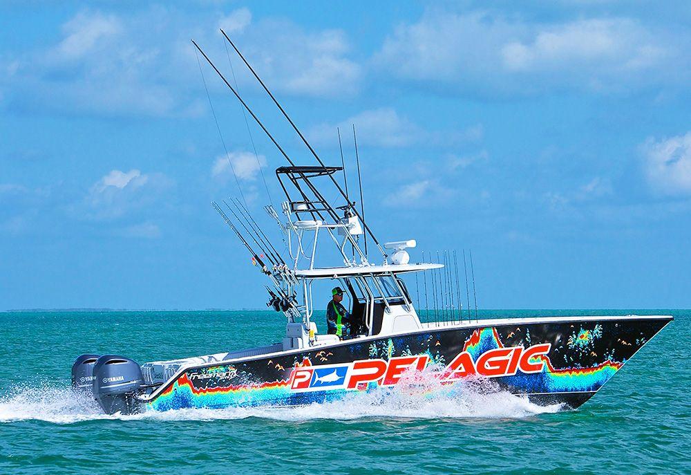 All Lit Up Fishing Charter Boat in Islamorada, Florida Keys - side view under power